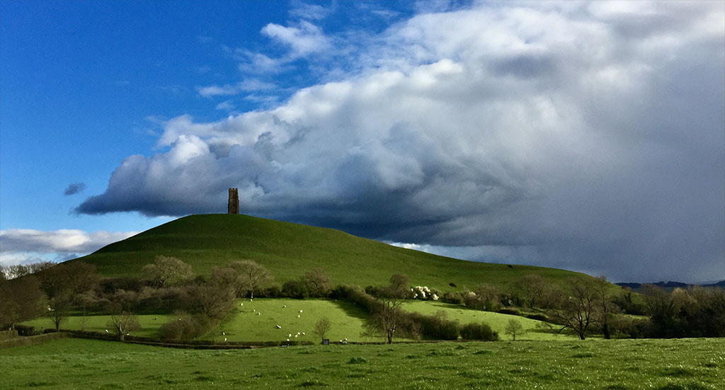 Glastonbury Tor and storm overhead